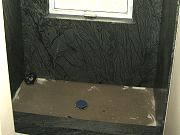 Rainforest Green Granite Installed in Office Shower. July 25, 2009